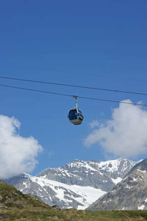 A small cable car in the swiss alps close to Matterhorn and the town of Zermatt photo
