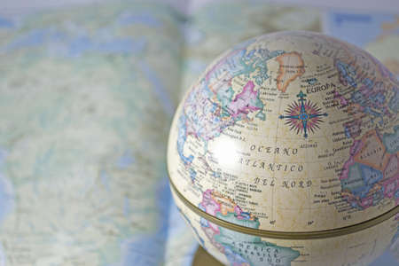 globe on an open atlas to maximize the search result Stock Photo