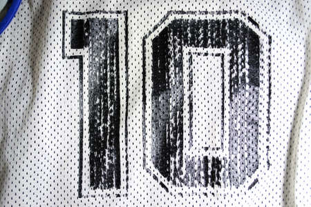 10: close up of an old basketall jersey number ten