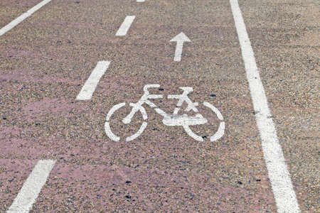 bike sign drawn in a bike lane