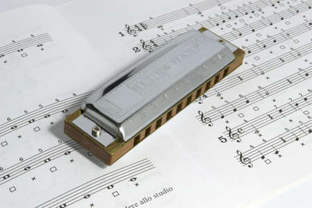 blues harp on an open stave Stock Photo