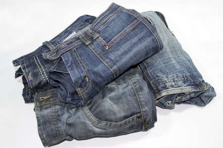 bluejeans: pile of several blue jeans over white background Stock Photo