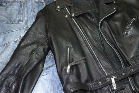 classic style leather studded jacket over denim pants 스톡 콘텐츠