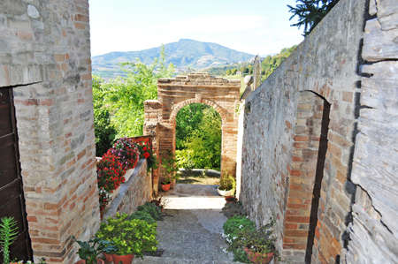 picturesque back alley in an old italian village Stock Photo