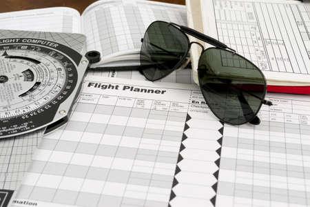 pilot style sunglasses on a flight plan paper Stock Photo