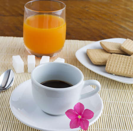 cup of coffee and glass of juice on a place mat