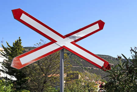 level crossing sign under a blue sky Stock Photo - 11296739