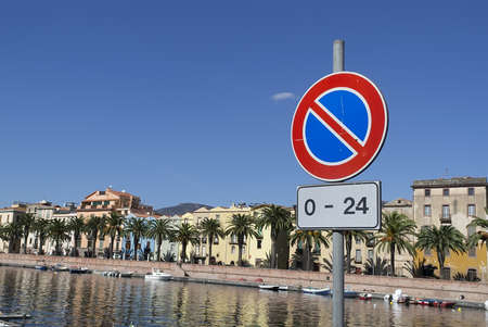 no parking road sign by Temo river in Bosa Stock Photo