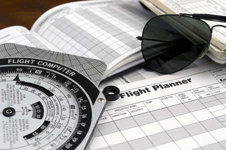pilot style sunglasses on a flight plan paper Stock Photo