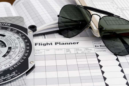 pilot style sunglasses on a flight plan paper Archivio Fotografico
