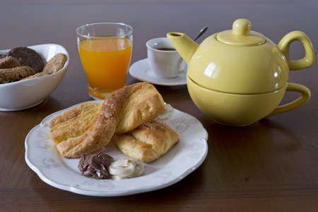breakfast set with snack, fruit juice, cookies photo