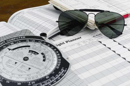 pilot style sunglasses on a flight plan paper Foto de archivo