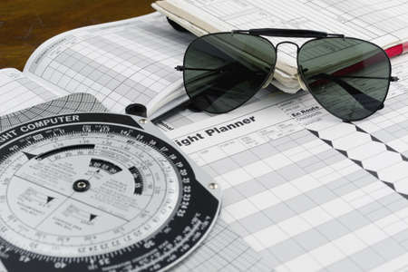 pilot style sunglasses on a flight plan paper photo