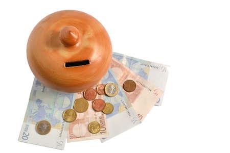 money box: ceramic money box on euro bills and coins Stock Photo