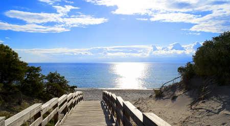 maria pia beach in Alghero, Sardinia, with sunlight reflection on water photo