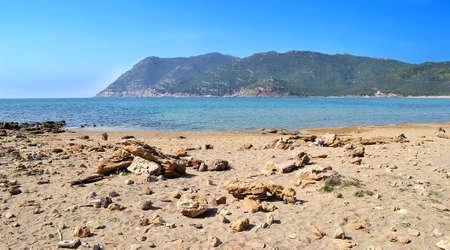 ferro: rocks and sand in Porto Ferro