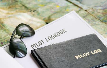 pilot sunglasses and logbook on a map Standard-Bild