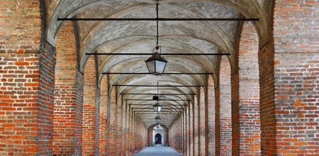 perspective view of a red bricks colonnade Stock Photo - 14313628