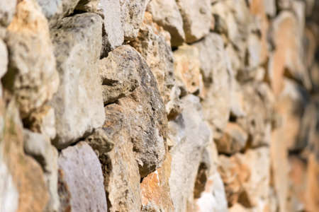 drystone: lateral view with selective focus of a dry-stone wall
