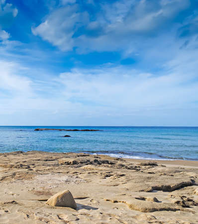 scenic view of a beach with sand under a cloudy sky Stock Photo - 16750837