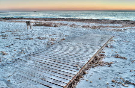boardwalk by the sea at sunset in hdr toning photo