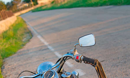 chromed: detail of a chromed motorcycle on the edge of the road