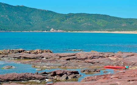 ferro: Porto Ferro coastline on a sunny day Stock Photo