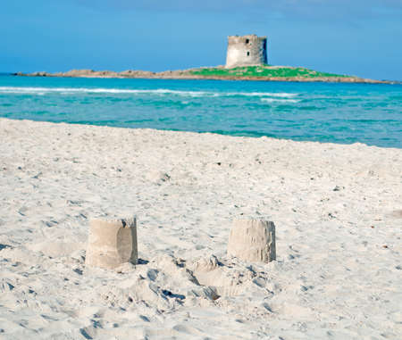 sand towers with Aragonese tower in the background Stock Photo - 18202373