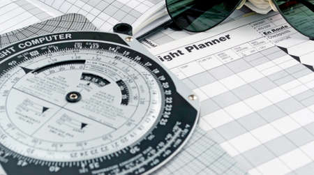 pilot style sunglasses on a flight plan paper photo