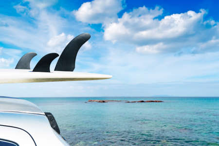 detail of surfboard fins with blue sea on the background Stock Photo