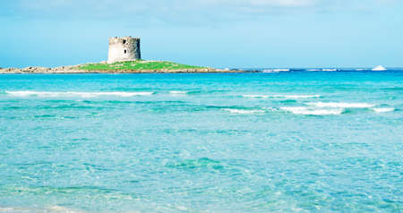 Aragonese tower on Stintino turquoise water Stock Photo - 18202055