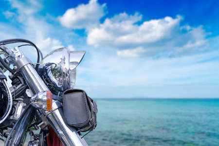 chromed motorcycle by the sea