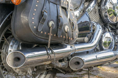 saddlebag: closeup of saddlebags and pipes of a classic style motorcycle