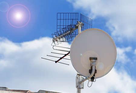 satellite dish under a bright sun Stock Photo