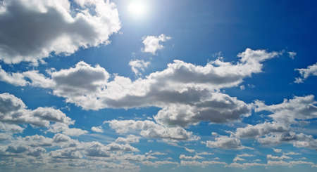 scattered white clouds in a blue sky Stock Photo