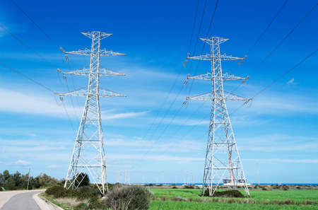 two electricity pylons on a clear day photo