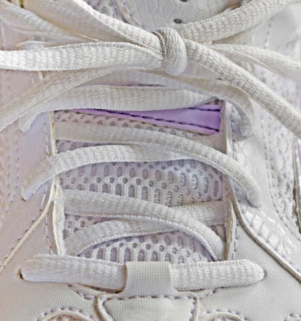 closeup of white running shoelace photo