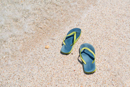 foreshore: flip flops by the foreshore Stock Photo