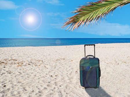 suitcase on a desert beach photo