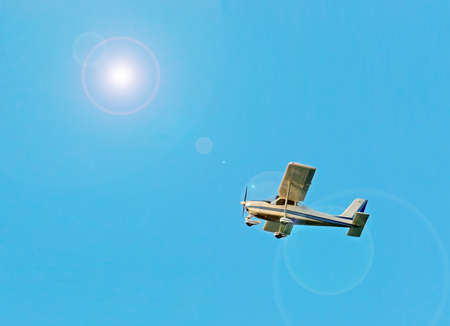 ultra light airplane under a bright sun Stock Photo