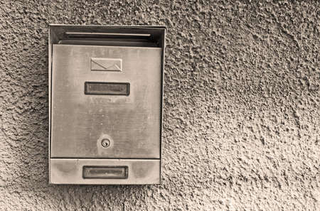 metal post: metal post  box on rustic wall in sepia tone Stock Photo