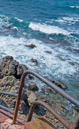 hand rail: rusty hand rail by Alghero rocky shore