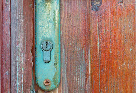 old metal key on wooden door photo