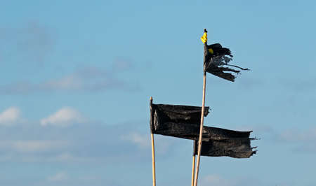 three black flag made of plastic
