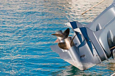 boat engine propellers over blue water Standard-Bild