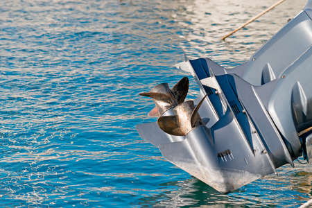 boat engine propellers over blue water Archivio Fotografico