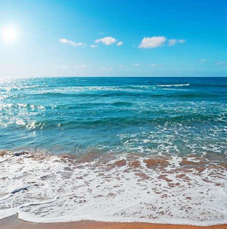 ferro: Porto Ferro shoreline under a bright sun Stock Photo