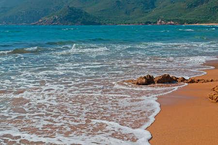 ferro: Porto Ferro golden shore on a windy day