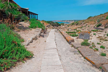 ���archeological site���: wooden path in Tharros archeological site Stock Photo