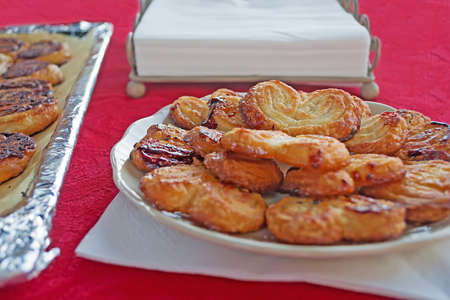 fan shaped: fan-shaped pastries on a red table